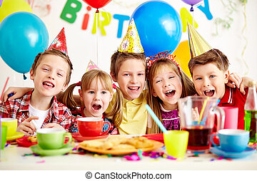 Birthday party - Group of adorable kids having fun at...