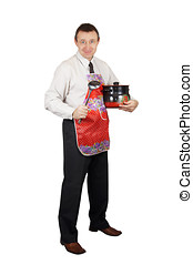 Smiling man with kitchen accessories