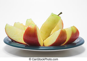 Sliced Red Apple - A red delicious apple sliced on a plate