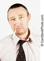 Unpleasant man with a cigarette