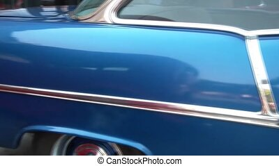 Pan of Midnight Blue Checy Classic Car - Left to right pan...