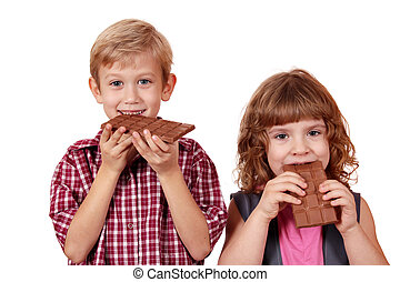 children eating chocolate - boy and little girl eating...