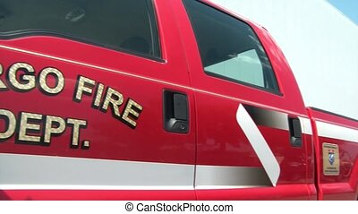 Pan of Fire Truck - Slight panning of red fire pickup truck...
