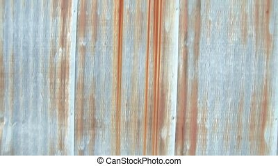 Pan up Rusty Metal Sheeting - Clip of camera panning up on...