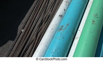 Panning Pvc Pipe and Rebar in Sun - Panning colored pvc...