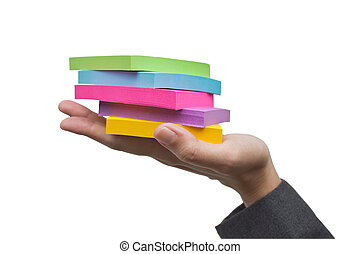 Colorful sticky notes in hand.