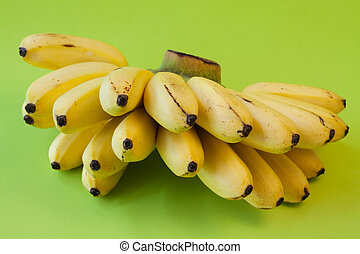 Yellow bananas isolated on green background