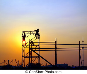 Construction Workers on a Scaffold - Construction workers...