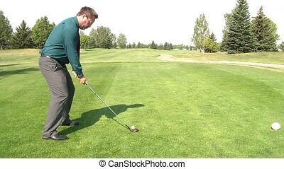 Playing Golf During Business Hours - Businessman sets up...