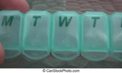 Pill Organizer Calculating Days - Fingers calculate days by...