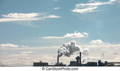 Pollution Fills Blue Sky - Pollution emits from distant...