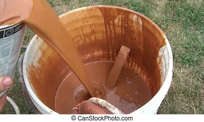 Pouring Stain Into Bucket