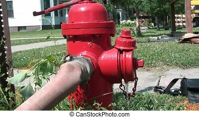 Red Fire Hydrant Leaking Water - Broken red fire hydrant...