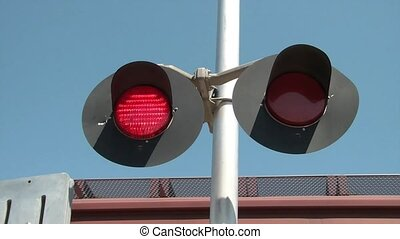 Red Railroad Lights with Passing Train - Red railroad lights...
