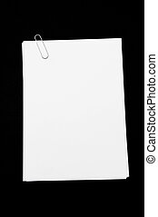 Memo pad and paper clip, high angle view