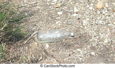 Rock Thrown at Bottle and Breaking - Rock is thrown at large...