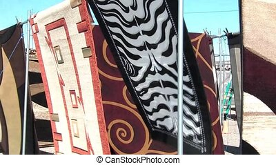 Rugs Blowing in Wind - Rugs blowing in the wind while hung...