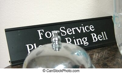 Ring Bell for Service Guest - Close up of silver colored...