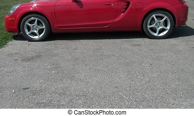 Red Sports Car Backing Up Slowly