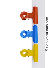 Memo pad and paper clip on white background