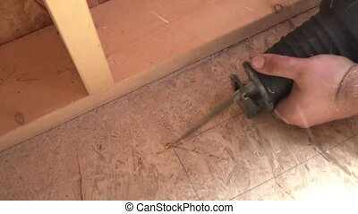 Sawing Through Floor - New Construction - Worker uses a...