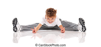 Boy gymnastic - Happy little boy doing splits isolated on...