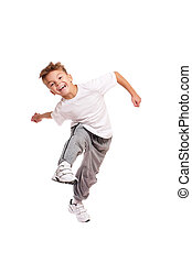 Boy jumping - Happy little boy jumping isolated on white...