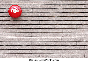 Red Fire Alarm on brick wall