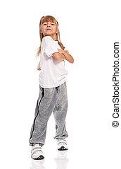 Little girl dancing - Happy little girl dancing isolated on...