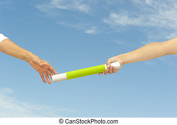Hands reaching baton for teamwork - Hands of track and field...