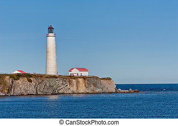 Cap des rosiers lighthouse during a cloudless day, Quebec,...