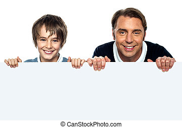 Father and son posing behind big blank banner ad. Isolated...