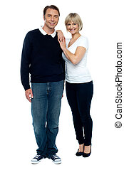 Casual portrait of trendy middle aged love couple. Full...