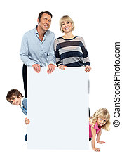 Lively family of four all around blank whiteboard - Post...