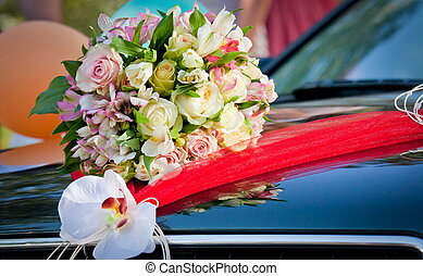 the beautiful wedding bouquet on the car