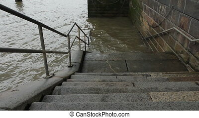 Steps into the Thames. - Stone steps with railing leading...