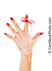Red bow on finger, concepts sclerosis - Red bow on finger,...