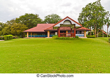 Red house on green lawn - The red house on green lawn In the...