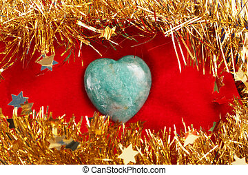 heart - A heart of a gem stone with a garland