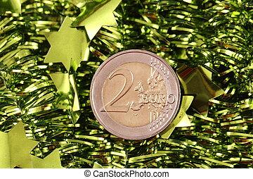 euro coin - A 2 Euro coin with a garland
