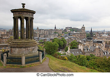 Calton Hill against Edinburgh with Castle, Balmoral Hotel and Scott Monument, UK