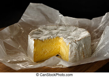 Camembert on a wooden board - Camembert cheese on a wooden...
