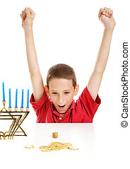 Boy Playing Dreidel on Hanukkah