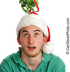 Surprised Young Man Under Mistletoe - Handsome young man...