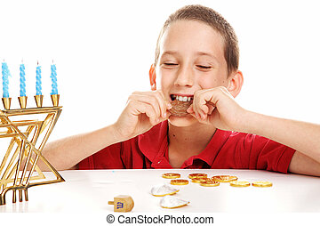 Eating Chocolate Gelt on Hanukkah - Little boy playing...
