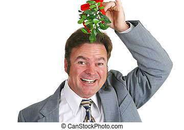 Hopeful Guy Under Mistletoe - Friendly businessman under the...