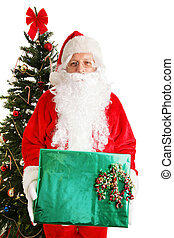 Santa by Christmas Tree with Gift