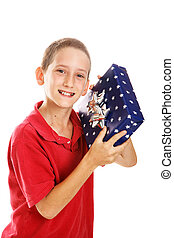 Little Boy Shaking Holiday Gift - Little boy shaking a gift...