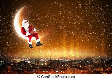 Santa on the moon - Santa Claus on the moon above a city at...