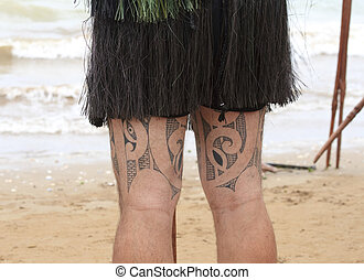Maori with tattoos on both legs - Legs with traditional...